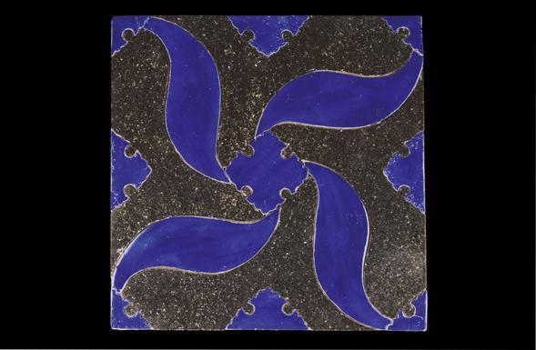deferranti-inlay-pinwheel-blue-ceramic-into-black-limestone-tile